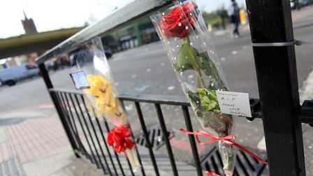 Flowers at the scene of a stabbing in Mile End in 2011. Picture: Joe Lord