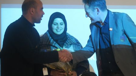 Refugee Sponsor foundation's director Tim Finch greets Syrian family at tonight's appeal launch. Pic