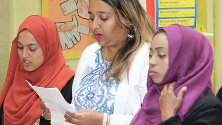 Parents perform poetry at Stewart Headlam School from what they've learned about avoiding loansharks