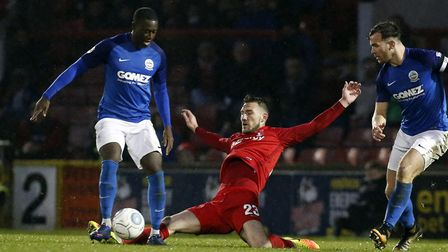 Leyton Orient midfielder Craig Clay slides in on a Dover Athletic opponent (pic: Simon O'Connor).