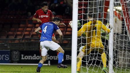 Leyton Orient forward Macauley Bonne heads towards goal, but is denied by the feet of Dover Athletic