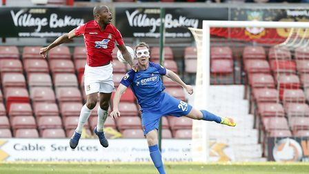 Leyton Orient defender Mark Ellis challenges for the ball in the air against a Wrexham opponent (pic