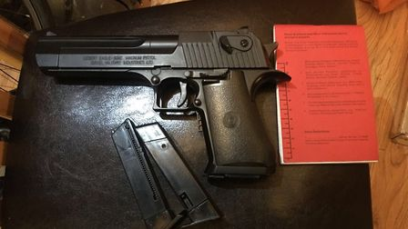Officers found a handgun at the address. Picture credit: Tower Hamlets Police.