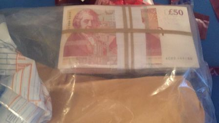 Police seized cash at the address. Picture credit: Tower Hamlets Police.