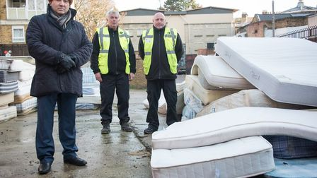 Deputy mayor Sirajul Islam and two caretakers with dumped mattresses outside Bay Court.Picture: Ju