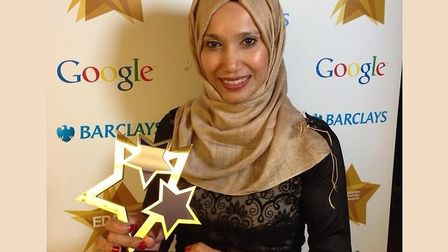 Cllr Rabina Khan in hijab winning EU 'community hero' award in 2014... now questions Ofsted's approa