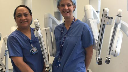 'Robot' surgeons ready to go into 'auto pilot' with their Da Vinci robotic medical equipment. Pictur
