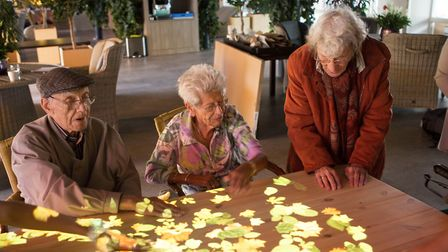 People with dememtia using the 'magic table'. Picture: Active Cues