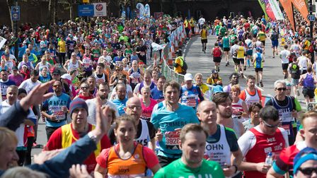 Blocking off Wapping once again... mass of runners along The Highway in the 2016 London Marathon. Ph