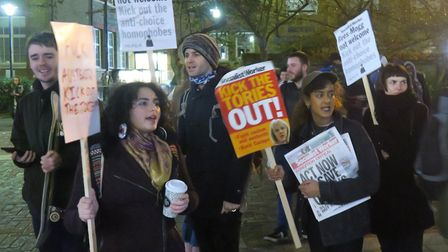 Banner-waving students protest at Rees-Mogg's lecture theatre talk at Queen Mary University. Picture