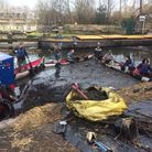 Volunteers collecting oil and rubbish by the River Lea in Hackney. Picture: Sophie Scott