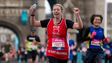 Kylie is all heart crossing Tower Bridge, running for the British Heart Foundation. Picture: Joe Tot