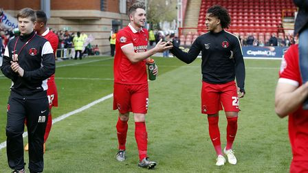 Leyton Orient duo Sandro Semedo (right) and Aron Pollock celebrate after making their full debuts fo