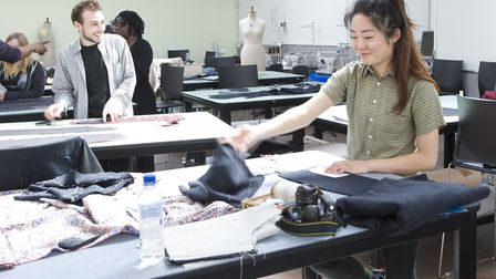 Designing tomorrow's fashion in a busy East End garment workshop. Picture: Jas Lehal