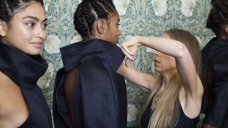 Final touches... fashionardos get ready for the catwalk. Picture: Yuvali Theis