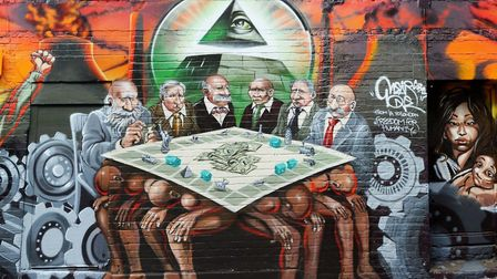 Anti-Semitic Brick Lane mural depicting grotesque imagery by artist 'Meah One' on a wall in Hanbury
