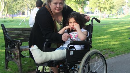 Grace Chessis and her broken leg with her mum Laura after being knocked over by a speeding cyclist i