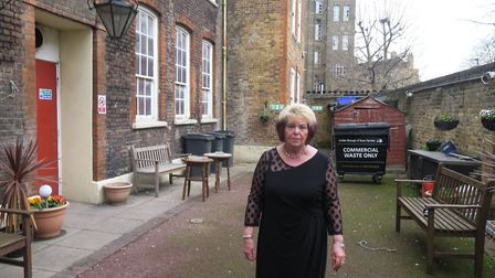 OAP Kathy Bracken, 70, in the back yard where the pensioners' social club gazebo and most of their g