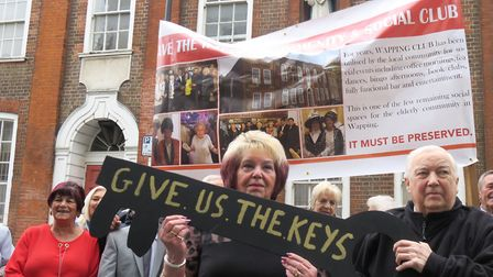 Pensioners protest outside Raine's House social club in Wapping to get back the keys to their social