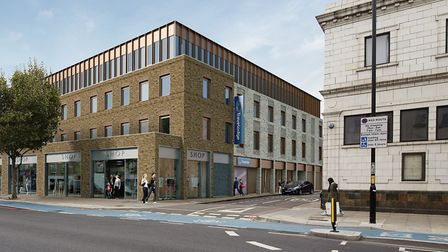 How the new Travelodge will look in 2020 next to the old municipal bath-house in the Mile End Road.