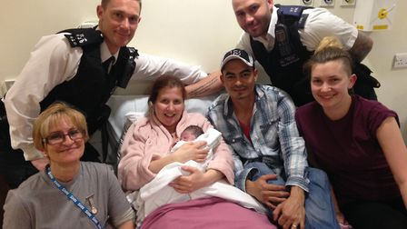 """Olivia Keogh after little Eva's dramatic birth, with midwives either side, her """"guardian angel"""" Pcs"""