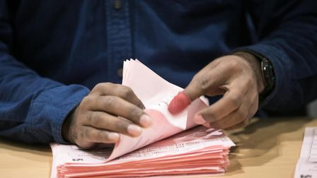 Checking every ballot paper carefully in Tower Hamlets election for mayor. Picture: Kios/LBTH