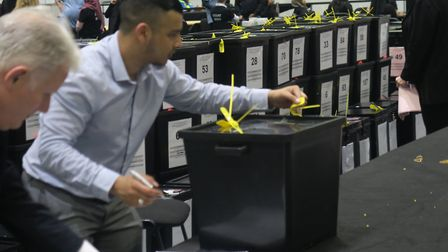 Making sure ballot boxes haven't been tampered with in Tower Hamlets elections. Photo: Mike Brooke