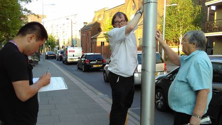 Campaigners from Reclaim Streets installing air monitoring devices in St Paul's Way. Picture source: