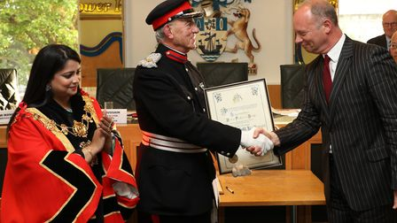 Cmdr Joihn Ludgate receiving the Freedom of the Borough from Tower Hamlets cheif executive Will Tuck