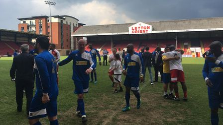 Players from Martin Ling's London Legends and Errol McKellar Celebrity XI leave the pitch