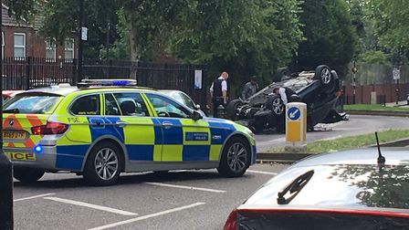 A 20-year-old woman was arrested after a car overturned in Stepney Green. Picture: Jim Drury