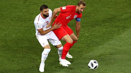 Tunisia's Syam Ben Youssef (left) and England's Harry Kane battle for the ball during the FIFA World