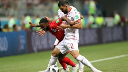 England's Raheem Sterling (left) and Tunisia's Syam Ben Youssef battle for the ball during the FIFA