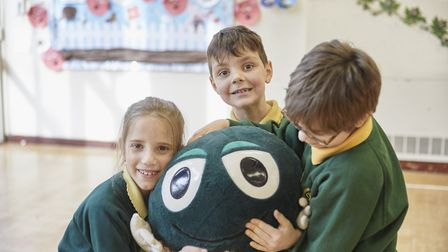 Pupuls with NSPCC mascot Buddy Picture: Tom Hull