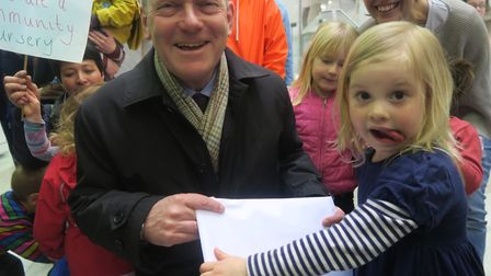 Toddler hands mayor John Biggs petition from mums and dads to stop Tower Hamlets closing its day car