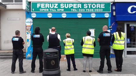 Tower Hamlets Homes ASB team and police outside Feruz Super Store. Pic: THH