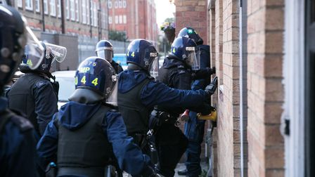Police storm an address in Fairclough Street, Whitechapel, during dawn raids earlier in June. Pictur