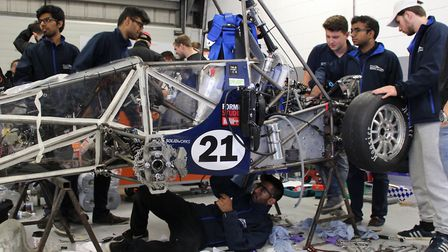 Queen Mary students assembling their racing car for Silverstone. Picture source: QMUL