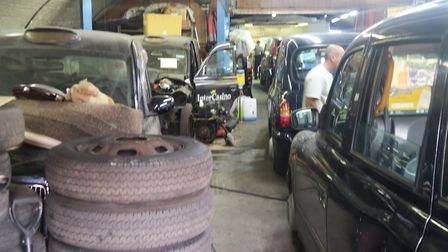 Busy taxicab service garage in railway arch in Bethnal Green. Picture: Mike Brooke