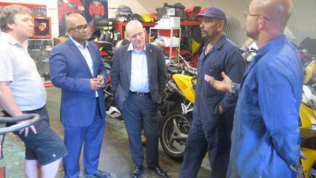 Mayor John Biggs (centre) meeting railway arch traders in Bancroft Road. Picture: Mike Brooke
