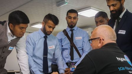 Hyperoptic engineer shows potential recruits how to wire up fibre optics. Picture: Kois Miah