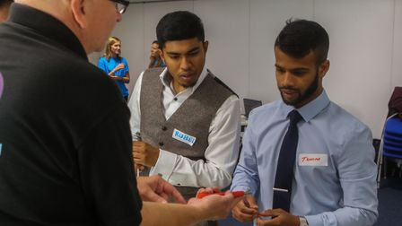 Practical demo... wannabe engineers try their hand at fibre optics wiring. Picture: Kois Miah