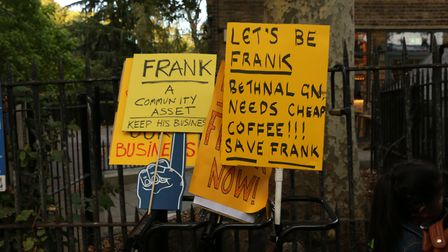 Protest signs from Frank's supporters, who said they'll be outraged if he's forced to move. Picture: