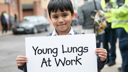 Message on a plackard from pupil at Bonner Primary that he wants to breath cleaner air. Picture: Koi