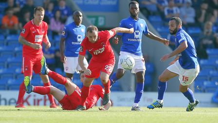 Charlie Lee looks to beat former Leyton Orient captain Robbie Weir to the ball (pic: Simon O'Connor)