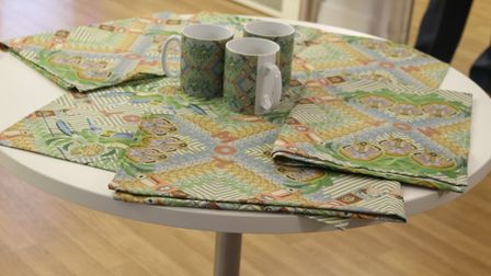 One of the Men's Cabin-inspired designs printed onto mugs and tea-towels on display at their Poplar