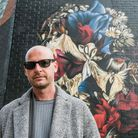 Gary McQueen by the mural in Ebor Street, Shoreditch, which was painted in tribute to his uncle, fas