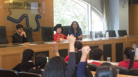 Hot debate... primary schoolchildren take on the big issues in Tower Hamlets council chamber. Pictur