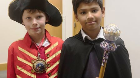 If the cap fits... two pupils dress up as the civic mayor and the council's mace-bearer. Picture sou