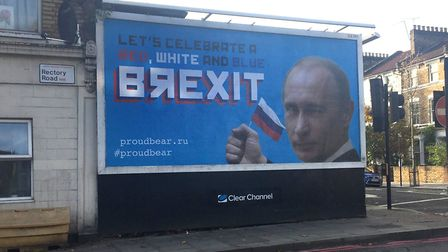 A billboard featuring Russian leader Vladimir Putin in Stoke Newington. Picture: Caitlin Doherty/PA